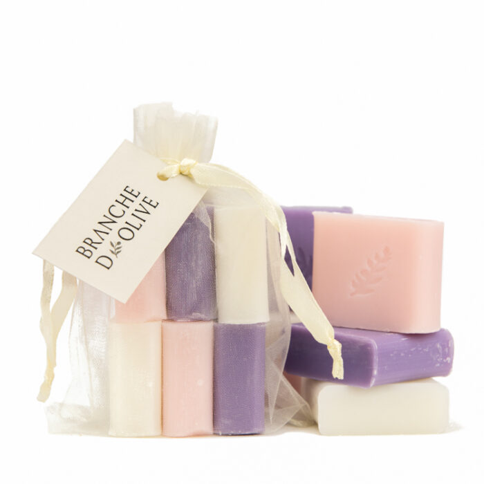 Six small Branche d'Olive Soaps of Lavender, Muguet (Lily of the Valley) and Rose fragrances in a cream drawstring bag
