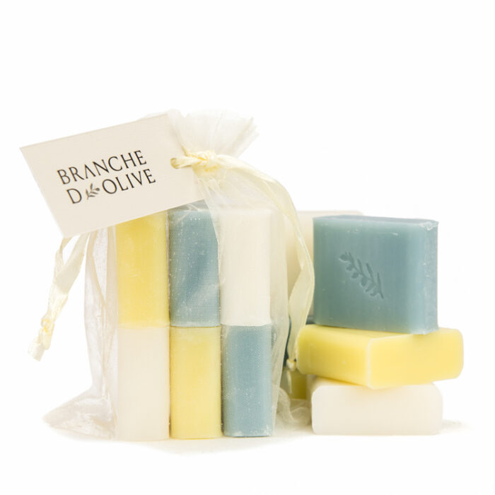 A mixture of Branche d'Olive soaps of Calanque, Muguet (Lily of the Valley) and Verbena fragrances in a cream organza bag