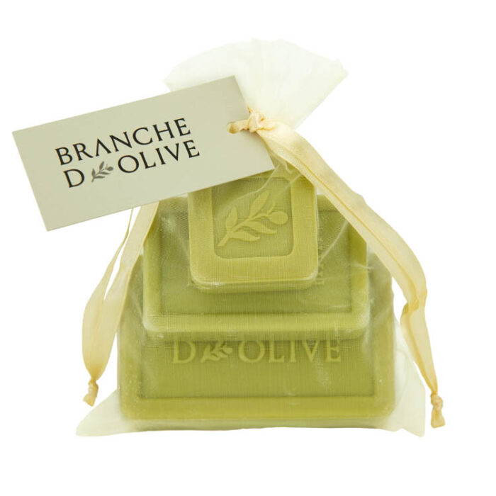 Tier of different sized Branche d'Olive Garrigue soaps wrapped in a voile bag