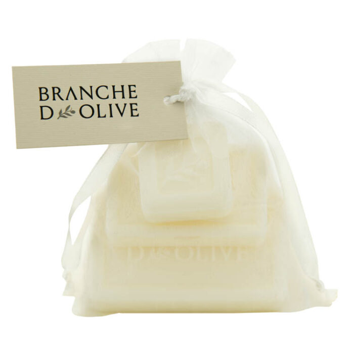 Tier of different sized Branche d'Olive Muguet soaps wrapped in a voile bag