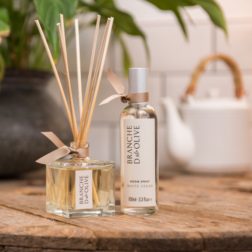 Branche d'Olive White Cedar scented Room Diffuser and Room Spray on a wooden table