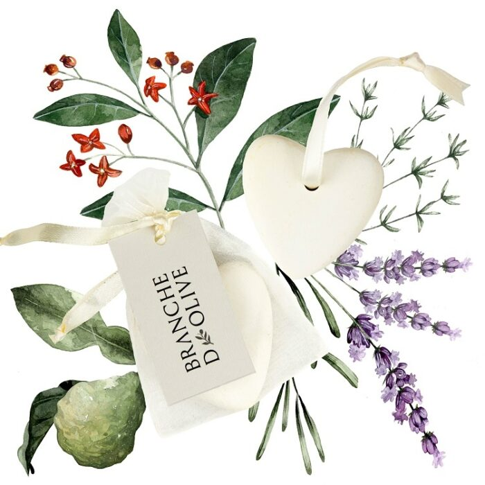 Branche d'Olive Garrigue Heart Soap in a voile bag with a painted floral background