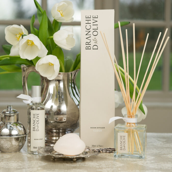 Branche d'Olive Cloud Room Diffuser, Room Spray and Heart Soap in front of white flowers