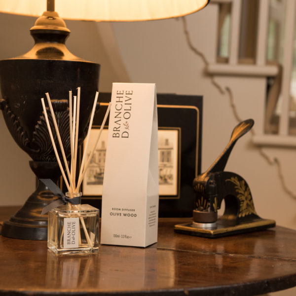 Branche d'Olive Olive Wood fragrance Room Diffuser on a wooden table at home